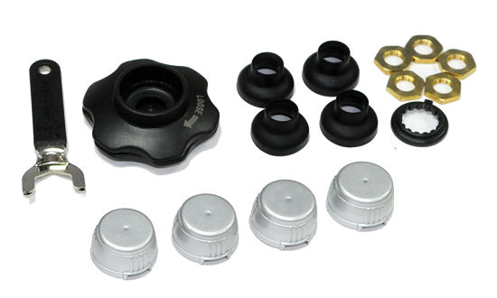 ... noch vier silberne Sensorkappen zwecks Anpassung der Optik sowie ein Set Knopfzellen des Typs CR 1632, vor Staub schützende Ventilabdeckungen, Unterlegscheiben, Muttern, ein Schraubenschlüssel und Werkzeug für einen einfachen Batteriewechsel